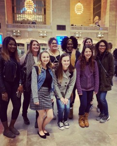 (IWL Director, Rachel Ferreira, featured with IWL Panel Members and Nichols Students in Grand Central Station, New York City before their tour of UN Headquarters)