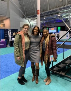 Marsha Johnson '19 and Mercy Jubin '20 pictured with Shayna Seymour Carr at the 2019 Massachusetts Conference for Women in Boston, MA.