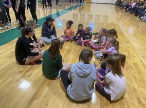 One of the groups getting to know each other with members of the NC women's ice hockey and soccer teams.